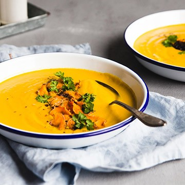 Creamy carrot ginger soup with sweet potato chips